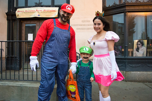 10/31/19 Wesley Bunnell | StaffrrAlfren Quiles, son Ethan Quiles and wife Maya Quiles dressed as Mario, Luigi and Princess Peach as they made the rounds as trick or treaters at the New Britain Down District Halloween Safe Zone 2019.