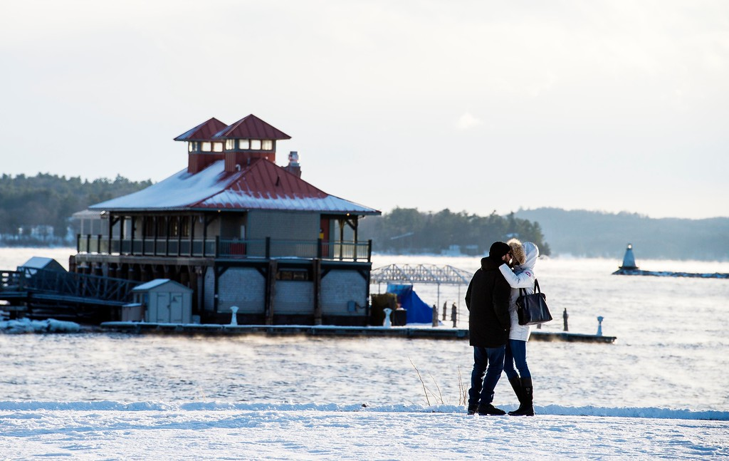 . A couple embraces as they brave the cold weather for a walk in Waterfront Park in Burlington, Vt., Wednesday, Dec. 27, 2017. Freezing temperatures and below-zero wind chills socked much of the northern United States on Wednesday. (Glenn Russell/The Burlington Free Press via AP)