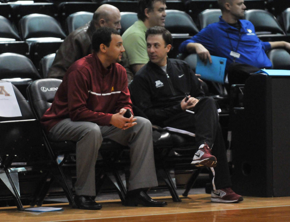 . University of Minnesota head basketball coach Richard Pitino, right, and assistant Ben Johnson watch high school basketball in the 2014 Minnesota Tiomberwolves Shootout at Target Center.(Pioneer Press: Scott Takushi)