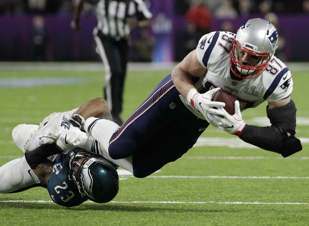 . Philadelphia Eagles free safety Rodney McLeod (23), tackles New England Patriots tight end Rob Gronkowski (87), during the first half of the NFL Super Bowl 52 football game, Sunday, Feb. 4, 2018, in Minneapolis. (AP Photo/Chris O\'Meara)