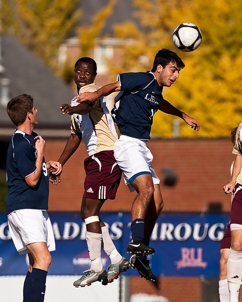 In the finals of the Big South Championship game Stephen Nsereko goes up for a ball against Juan Guzman.  Guzman wins the ball, Nsereko wins the look!