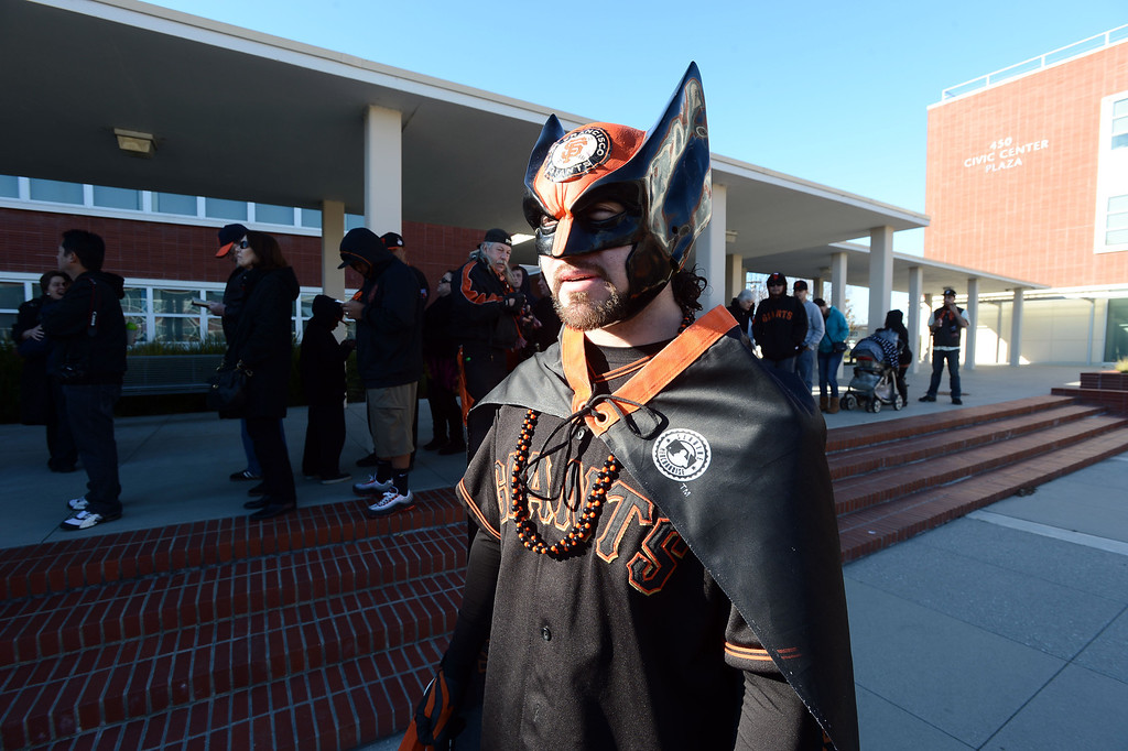 . Erik Lopez wears his Giants Wolverine outfit as he waits in line to see the World Series Trophy as it makes a stop at the Richmond Memorial Auditorium in Richmond, Calif. on Monday, Jan. 14, 2013.  (Kristopher Skinner/Staff)