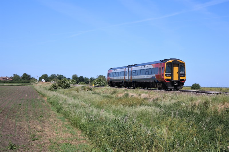 158783 passing Wisbech Road crossing, Manea at 1203/1R82 Norwich to Liverpool