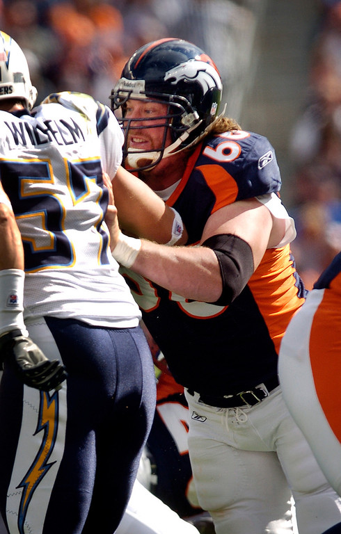 . Broncos center Tom Nalen blocks Charger linebacker  Matt Wilhelm in Sunday\'s loss against the Chargers on October 7th, 2007 at Invesco Field.  Nalen, a 14-year center who has played in more Broncos games other than John Elway and Jason Elam, suffered a torn right biceps in the first quarter of the game against the Chargers. Nalen finished the game but an MRI exam  revealed the biceps tear that will require surgery and a four-month recovery.Cyrus McCrimmon / The Denver Post