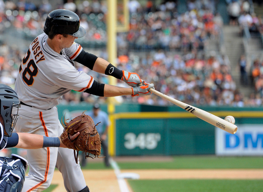 . San Francisco Giants� Buster Posey hits a single against the Detroit Tigers in the eighth inning of a baseball game Saturday, Sept. 6, 2014, in Detroit.  The Giants won 5-4.  (AP Photo/Jose Juarez)