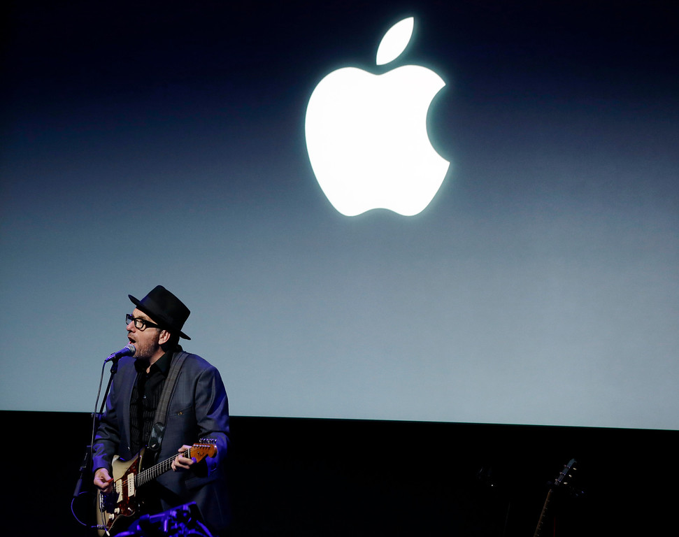 . Elvis Costello, performs after the new product release in Cupertino, Calif., Tuesday, Sept. 10, 2013.   (AP Photo/Marcio Jose Sanchez)