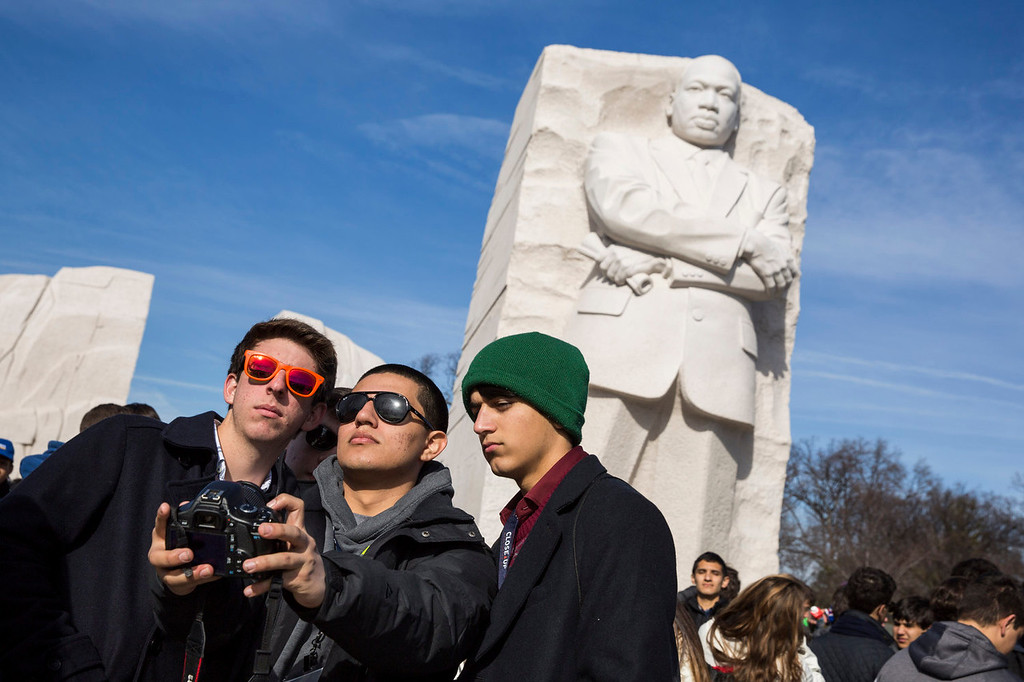 . WASHINGTON, DC - JANUARY 20:  High school students from Thibodaux, Louisiana take a photo of themselves at the Martin Luther King, Jr. Memorial, January 20, 2014 in Washington, DC. Americans marked the birth and legacy of civil rights leader Martin Luther King, Jr. (Photo by Drew Angerer/Getty Images)