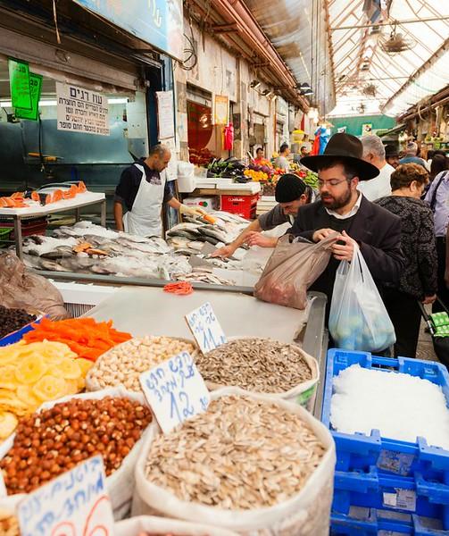 Jerusalem, Israel - November 15, 2012 - people are shopping at Mahane Yehuda - famous market in Jeru