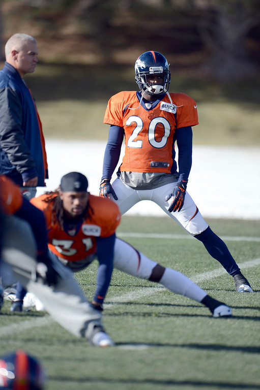 . Denver Broncos strong safety Mike Adams (20) stretches during practice Wednesday, December 12,  2012 at Dove Valley.  John Leyba, The Denver Post
