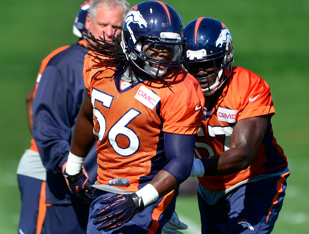 . Nate Irving (56) works through drills with fellow linebacker Lamin Barrow. The Denver Broncos football team gets in their final day of practice during training camp at Dove Valley  on Friday, Aug. 15, 2014. (Photo by Kathryn Scott Osler/The Denver Post)