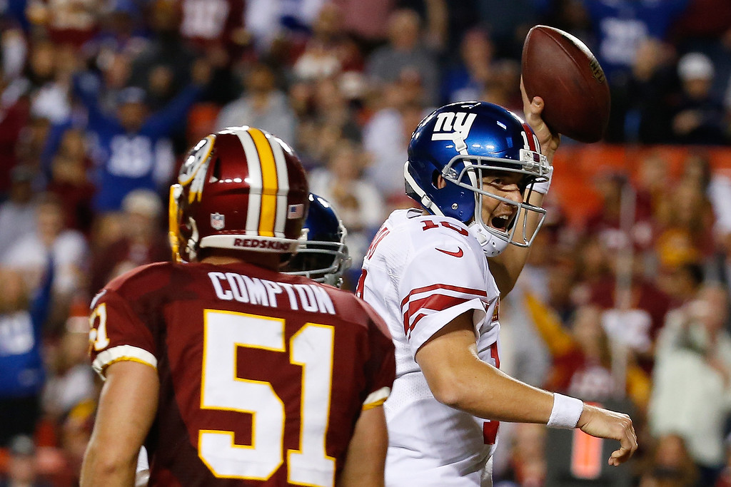 . New York Giants quarterback Eli Manning (10) celebrates his touchdown during the second half of an NFL football game against the Washington Redskins in Landover, Md., Thursday, Sept. 25, 2014. (AP Photo/Alex Brandon)