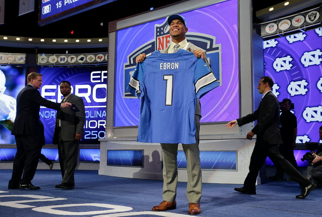. North Carolina tight end Eric Ebron poses for photos after being selected by the Detroit Lions as the 10th pick in the first round of the 2014 NFL Draft, Thursday, May 8, 2014, in New York. (AP Photo/Craig Ruttle)