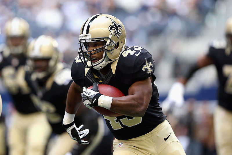 . Darren Sproles #43 of the New Orleans Saints runs the ball against the Dallas Cowboys at Cowboys Stadium on December 23, 2012 in Arlington, Texas.  (Photo by Ronald Martinez/Getty Images)