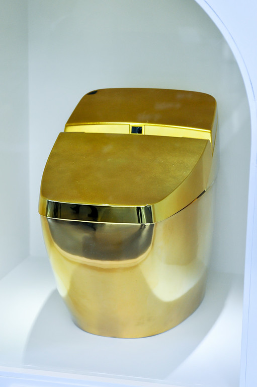 ". TOKYO, JAPAN - JULY 01:  A gold toilet is displayed during the ""Toilet!? Human Waste and Earth\'s Future\"" exhibition at The National Museum of Emerging Science and Innovation - Miraikan on July 1, 2014 in Tokyo, Japan. The exhibition focuses on how the toilet has changed our daily lives and discovers what the most environment-friendly and ideal toilet is.  (Photo by Keith Tsuji/Getty Images)"