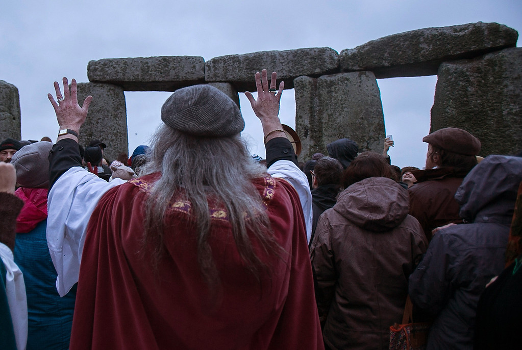 . Rollo Maughfling, Archdruid of Stonehenge & Britain, turns to the stones as he conducts a ceremony as druids, pagans and revellers gather, hoping to see the sun rise as they take part in a winter solstice ceremony at Stonehenge on December 21, 2013 in Wiltshire, England.  (Photo by Matt Cardy/Getty Images)