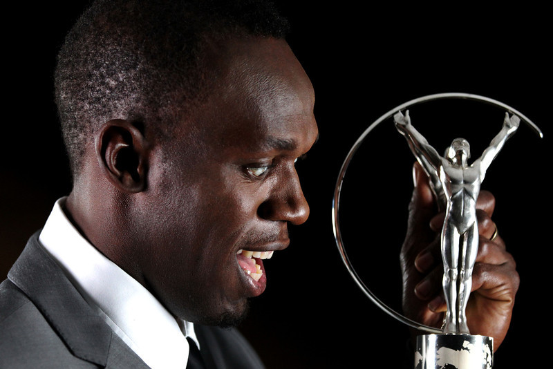 . Sprinter Usain Bolt of Jamaica poses with the award for Laureus World Sportsman of the Year in the winners studio during the 2013 Laureus World Sports Awards at Theatro Municipal do Rio de Janeiro on March 11, 2013 in Rio de Janeiro, Brazil.  (Photo by Marc Serota/Getty Images For Laureus)