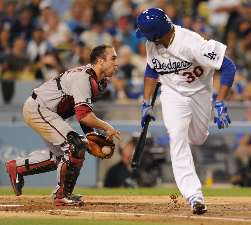 . Dodger pitcher Edinson Volquez looks back at Dback catcher Miguel Montero after laying down a bunt that scored Juan Uribe in the 2nd inning. The Dodgers played the Arizona Diamondbacks at Dodger Stadium in Los Angeles, CA. 9/10/2013. photo by (John McCoy/Los Angeles Daily News)