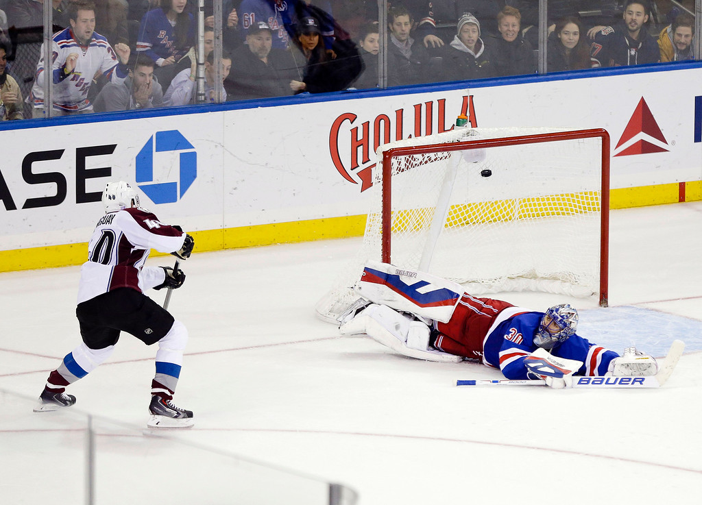 . Colorado Avalanche left wing Alex Tanguay (40) scores on New York Rangers goalie Henrik Lundqvist (30), of Sweden, during the shootout period of an NHL hockey game Thursday Nov. 13, 2014. The Colorado Avalanche won 4-3. (AP Photo/Frank Franklin II)