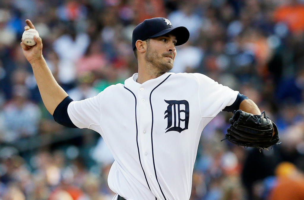 . Detroit Tigers starting pitcher Rick Porcello throws during the first inning of a baseball game against the Seattle Mariners, Friday, Aug. 15, 2014, in Detroit. (AP Photo/Carlos Osorio)