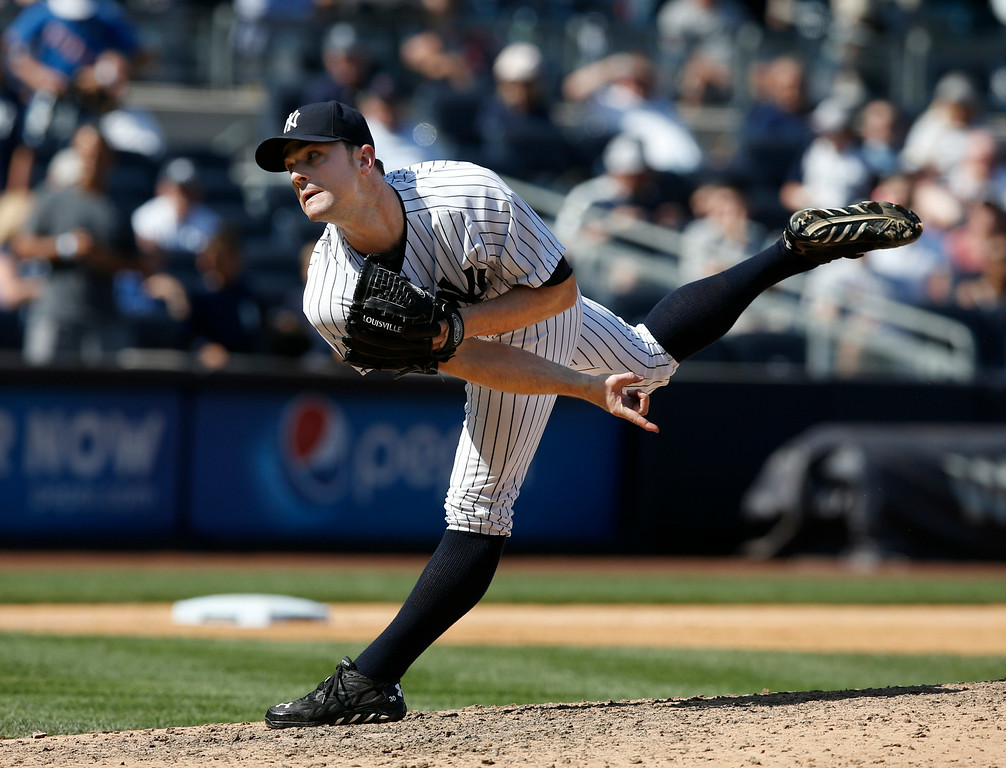 . New York Yankees relief pitcher David Robertson (30) follows through on a ninth-inning pitch in a baseball game against the Detroit Tigers at Yankee Stadium in New York, Thursday, Aug. 7, 2014. Robertson earned the save as the Yankees defeated the Tigers 1-0. (AP Photo/Kathy Willens)