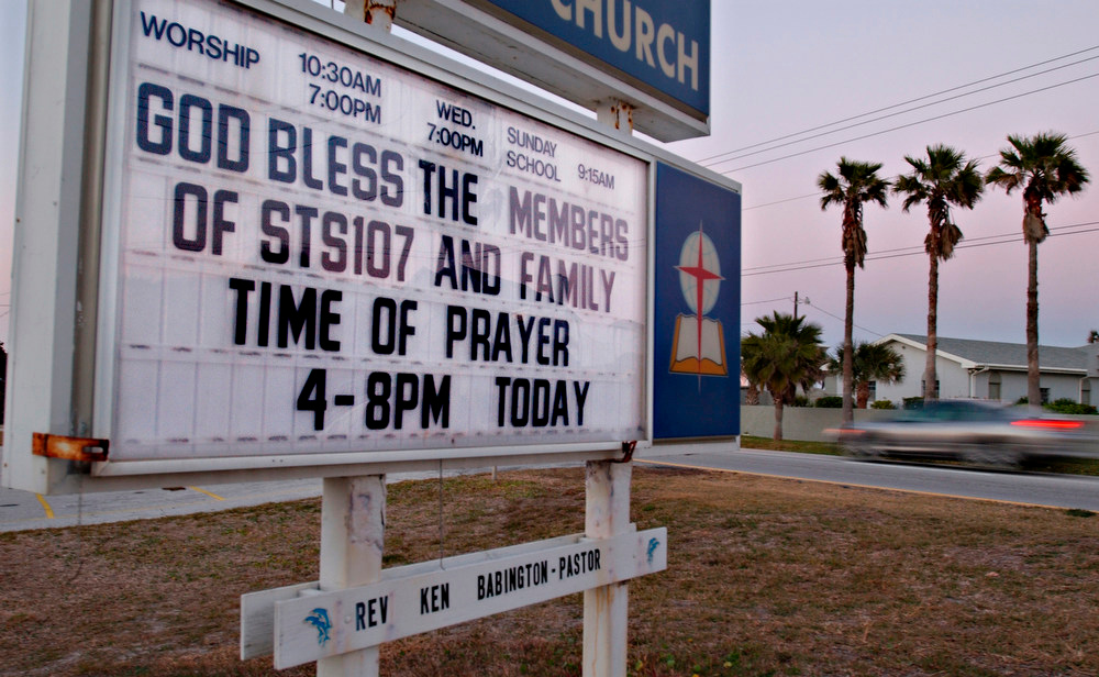 . A memorial message for the Columbia astronauts and their families is seen on a sign at the First Baptist Church in Cocoa Beach, Fla., Saturday, Feb. 1, 2003. (AP Photo/Florida Today, Craig Rubadoux)