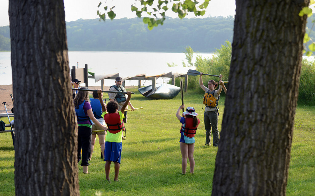 . Future canoers gather on shore for instruction before taking to the water at Fort Snelling State Park. (Pioneer Press: Chris Polydoroff)