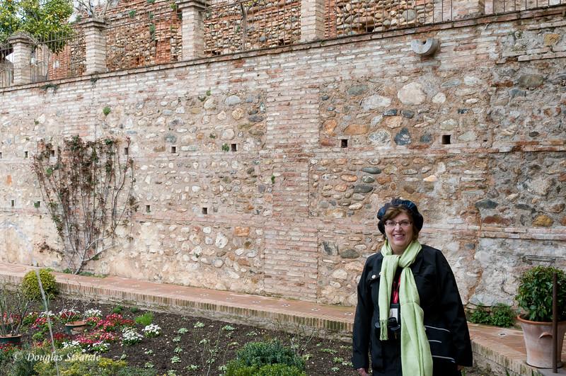 Fri 3/11 at La Alhambra in Grenada: Louise by a garden wall