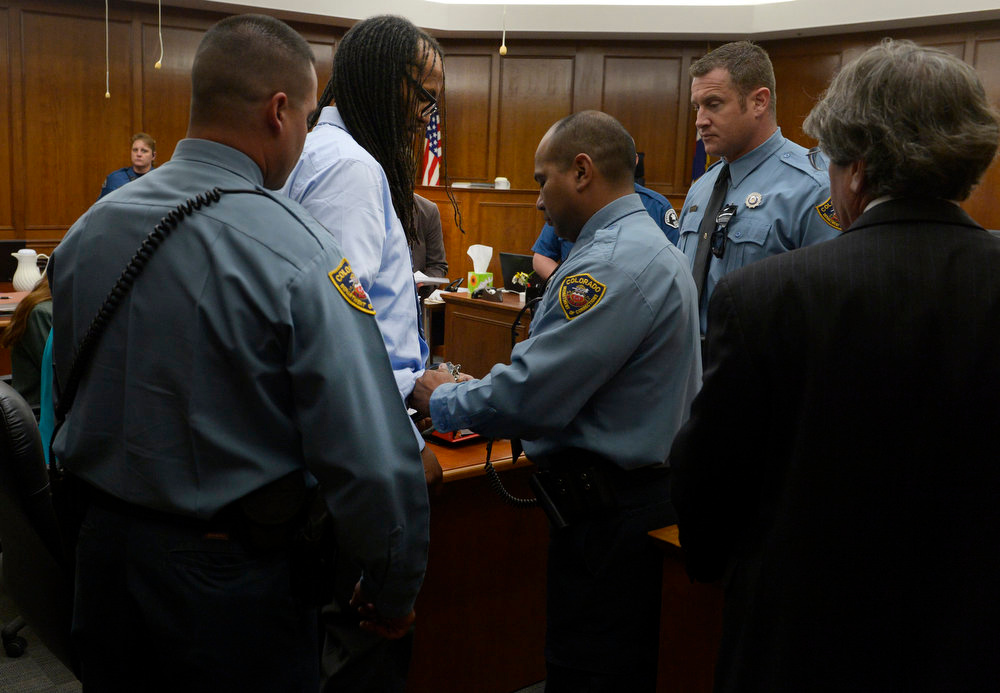 . Deputies put handcuffs back on Convicted killer Nathan Dunlap as he is prepared to walk out of the courtroom.   Judge William Sylvester set an execution date for Dunlap for the week of  August 14th 2013. The hearing held today was to  set a date for the execution of convicted murderer Nathan Dunlap at the Arapahoe County Court in Division court room 408  in Centennial, CO on May 1, 2013.   Judge William Sylvester is the presiding judge on the case.  (Photo by Helen H. Richardson/The Denver Post)