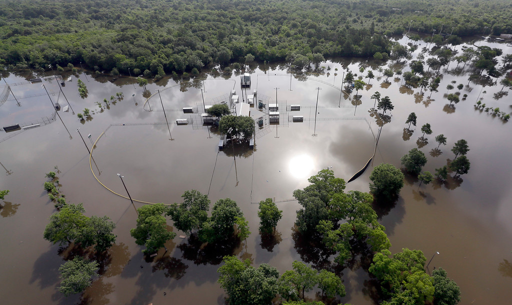 . Baseball fields Bear Creek Park are covered by floodwaters  Saturday, May 30, 2015, in Houston. The Colorado River in Wharton and the Brazos and San Jacinto rivers near Houston are the main focus of concern as floodwaters moved from North and Central Texas downstream toward the Gulf of Mexico. (AP Photo/David J. Phillip)