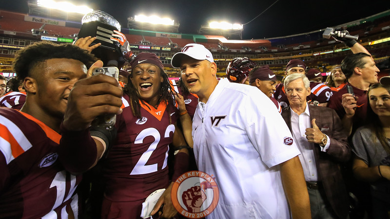 Terrell Edmunds (22) takes a selfie with head coach Justin Fuente. (Mark Umansky/TheKeyPlay.com)