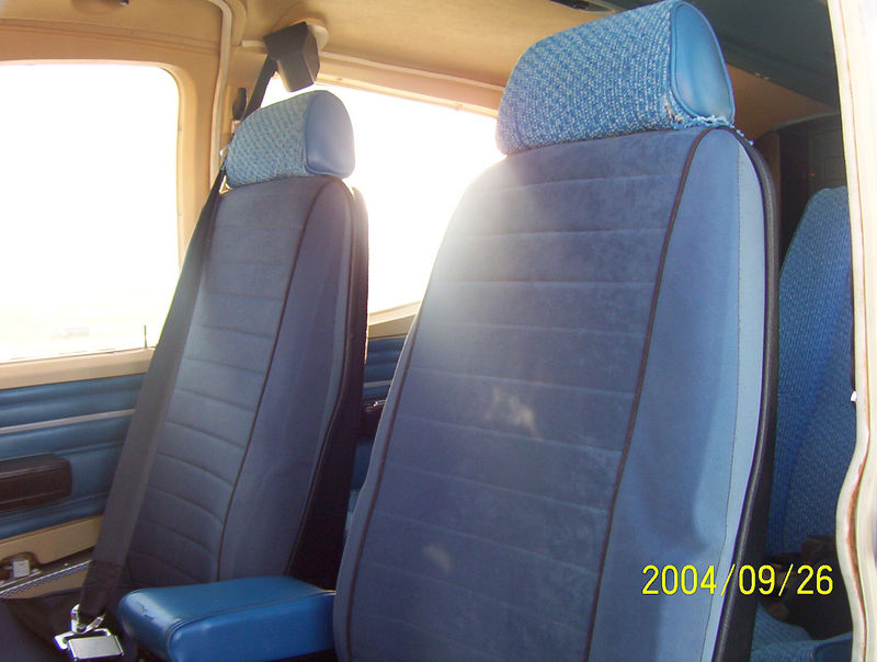 Old blue interior with the blue factory vinyl side panels.  I replaced the sheep skin seat covers with an equally cheap set I got from the auto store.