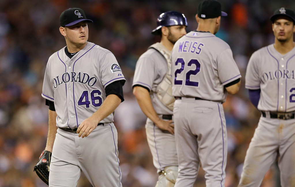 . Colorado Rockies starting pitcher Tyler Matzek (46) is relieved by manager Walt Weiss (22) during the fifth inning of an interleague baseball game against the Detroit Tigers, Saturday, Aug. 2, 2014, in Detroit. (AP Photo/Carlos Osorio)