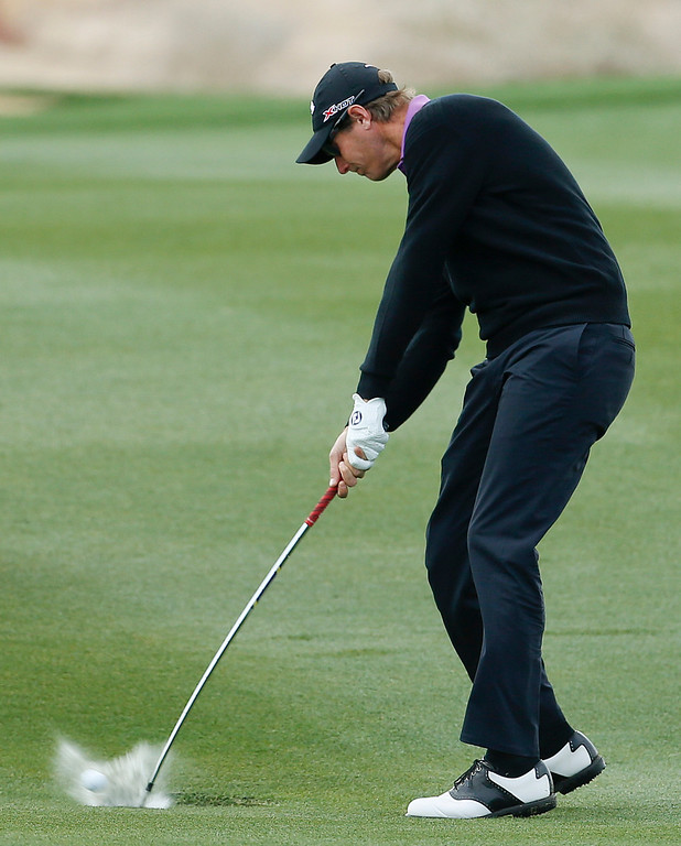 . Nicolas Colsaerts, of Belgium, hits out of standing water on the 13th fairway in the first round against Bill Haas during the Match Play Championship golf tournament, Thursday, Feb. 21, 2013, in Marana, Ariz. Colsaerts won 5 and 4. (AP Photo/Ross D. Franklin)