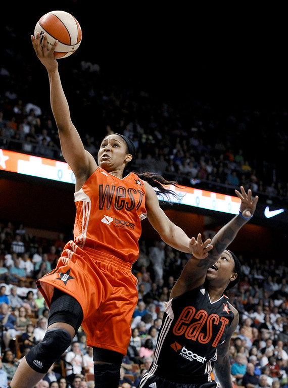 . West\'s Maya Moore, left, of the Minnesota Lynx, goes up for a basket while guarded by East\'s Cappie Pondexter, of the New York Liberty, during the first half of the WNBA All-Star Game on Saturday. The West won 102-98. (AP Photo/Jessica Hill)