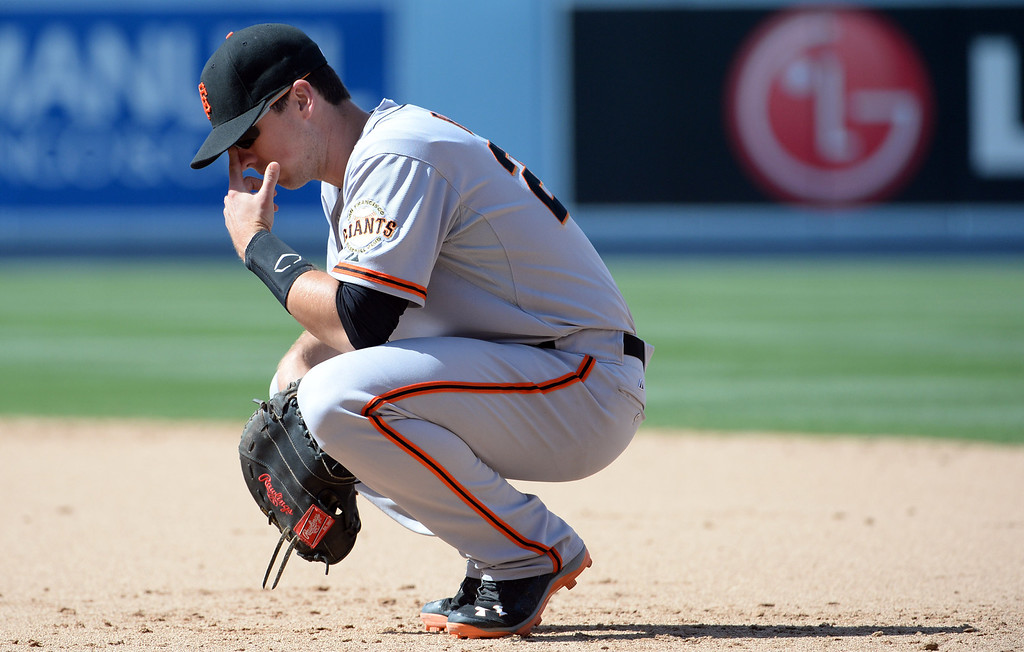 . San Francisco Giants first baseman Buster Posey after the Los Angeles Dodgers take the led in the seventh inning of a Major league baseball game on Saturday, May 10, 2013 in Los Angeles.   (Keith Birmingham/Pasadena Star-News)