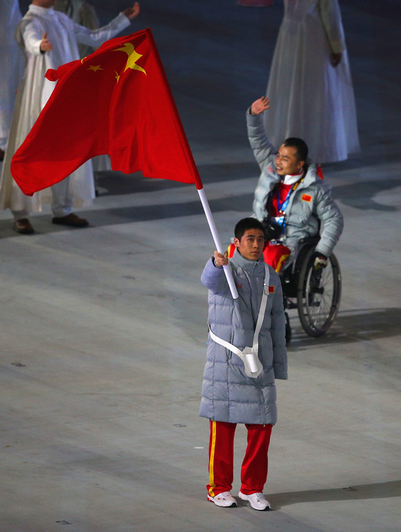 . Ye Tian of China bears the flag during the Opening Ceremony of the Sochi 2014 Paralympic Winter Games at Fisht Olympic Stadium on March 7, 2014 in Sochi, Russia.  (Photo by Hannah Peters/Getty Images)
