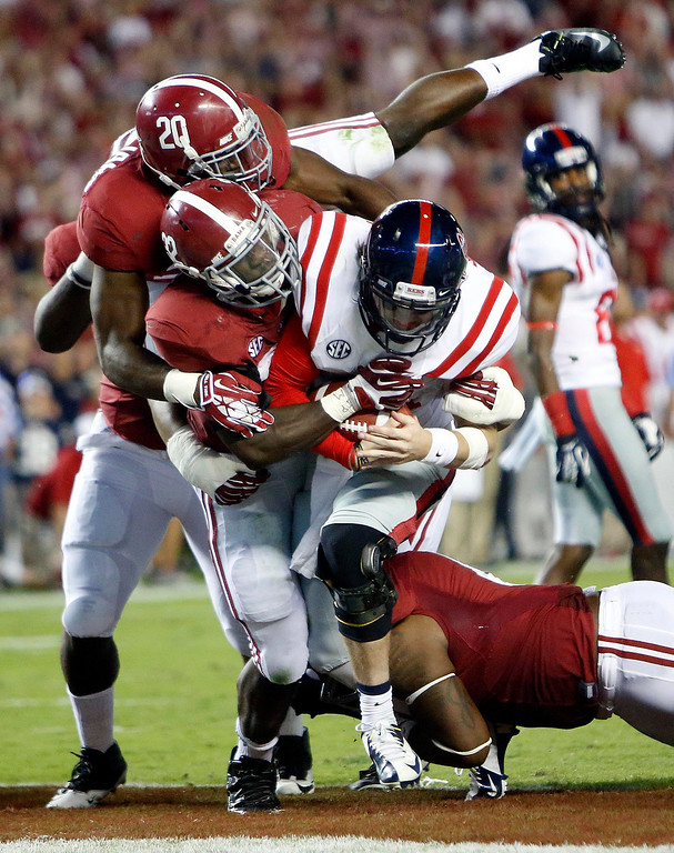 . Alabama defenders bring down Mississippi quarterback Bo Wallace (14) in the end zone for a safety in the fourth quarter of an NCAA college football game in Tuscaloosa, Ala., Saturday, Sept. 28, 2013. (AP Photo/Tuscaloosa News, Dusty Compton)