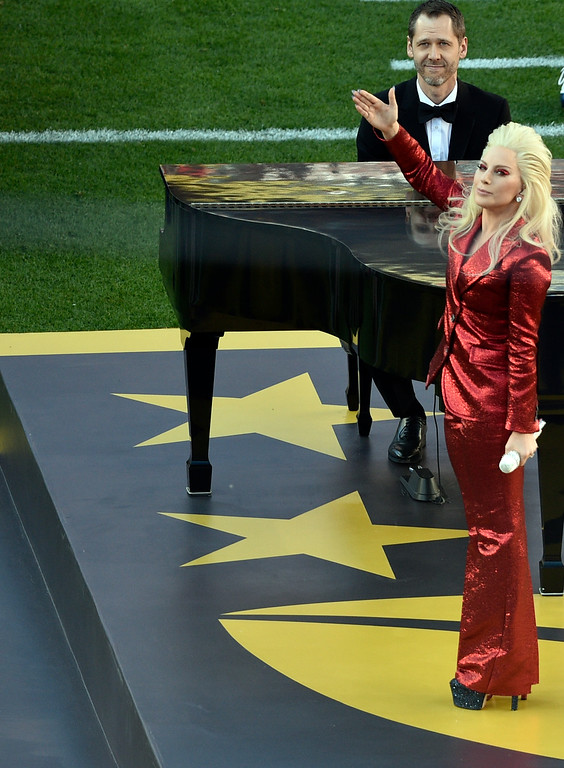 . SANTA CLARA, CA - FEBRUARY 7: Lady Gaga waves to the crowd after singing the National Anthem.  The Denver Broncos played the Carolina Panthers in Super Bowl 50 at Levi\'s Stadium in Santa Clara, Calif. on February 7, 2016. (Photo by Helen H. Richardson/The Denver Post)