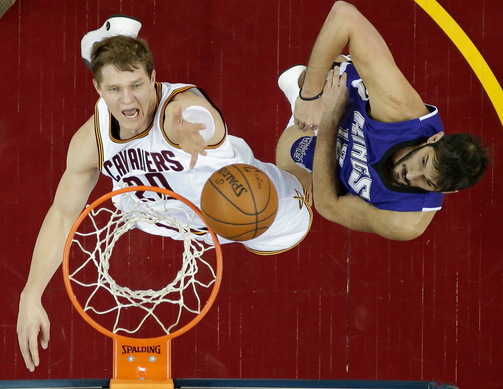 . Cleveland Cavaliers\' Timofey Mozgov (20), from Russia, drives to the basket against Sacramento Kings\' Omri Casspi (18), from Israel, in the first half of an NBA basketball game Monday, Feb. 8, 2016, in Cleveland. (AP Photo/Tony Dejak)