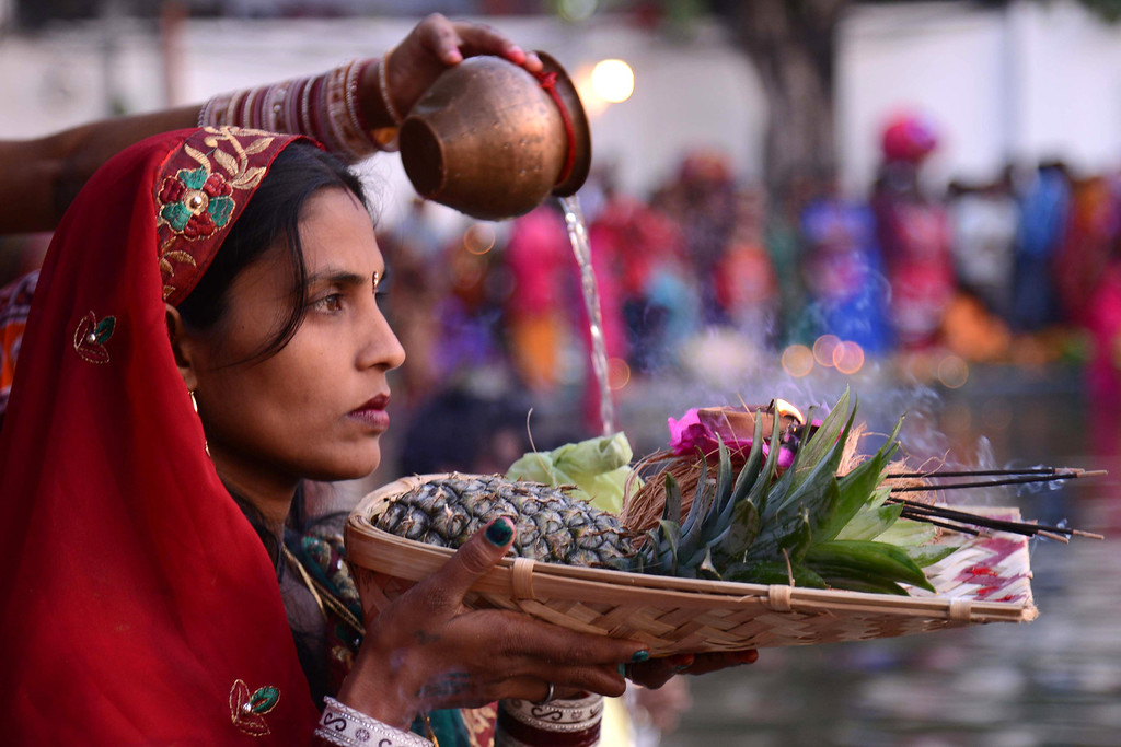 . Indian Hindu devotees offer prayer during the \'Chhat Puja \'while standing in the sarover (water tank) of the Durgiana temple in Amritsar on November 8, 2013.    AFP PHOTO /NARINDER NANU/AFP/Getty Images