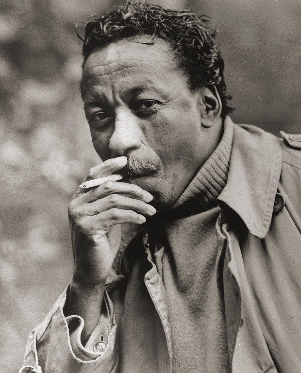 ". This 1966 photo shows photographer Gordon Parks. Parks, who captured the struggles and triumphs of black America as a photographer for Life magazine and then became Hollywood\'s first major black director with ""The Learning Tree\"" and the hit \""Shaft,\"" died March 7, 2006. He was 93. (AP Photo/Adelaide de Menil)"