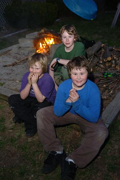 4/28/07 boys kids family burning marshmallows in backyard at Manning place
