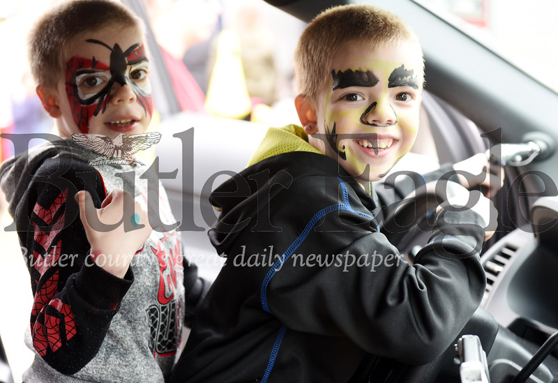 Harold Aughton/Butler Ealge: Six-year-old, twin brothers, Xavier, and Tyson Schrecengost of Butler explore the inside of a Pennsylvania State Trooper's car at the Butler Bike Rodeo, Sunday afternoon.