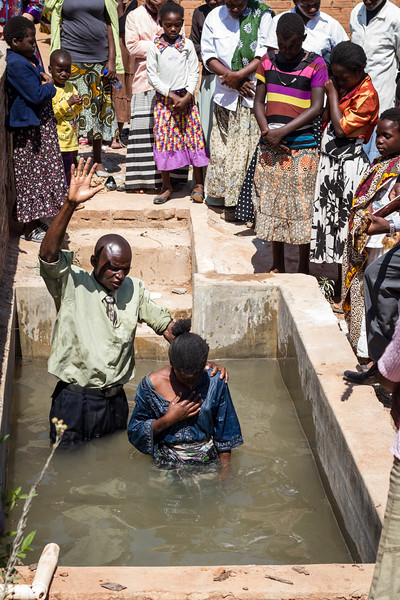 Brother Ben and a crowd of people singing and praying join some young sisters as they decide they are ready to be baptized.
