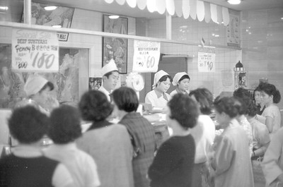 All the ladies patiently awaiting their turn at the meat counter.  1965