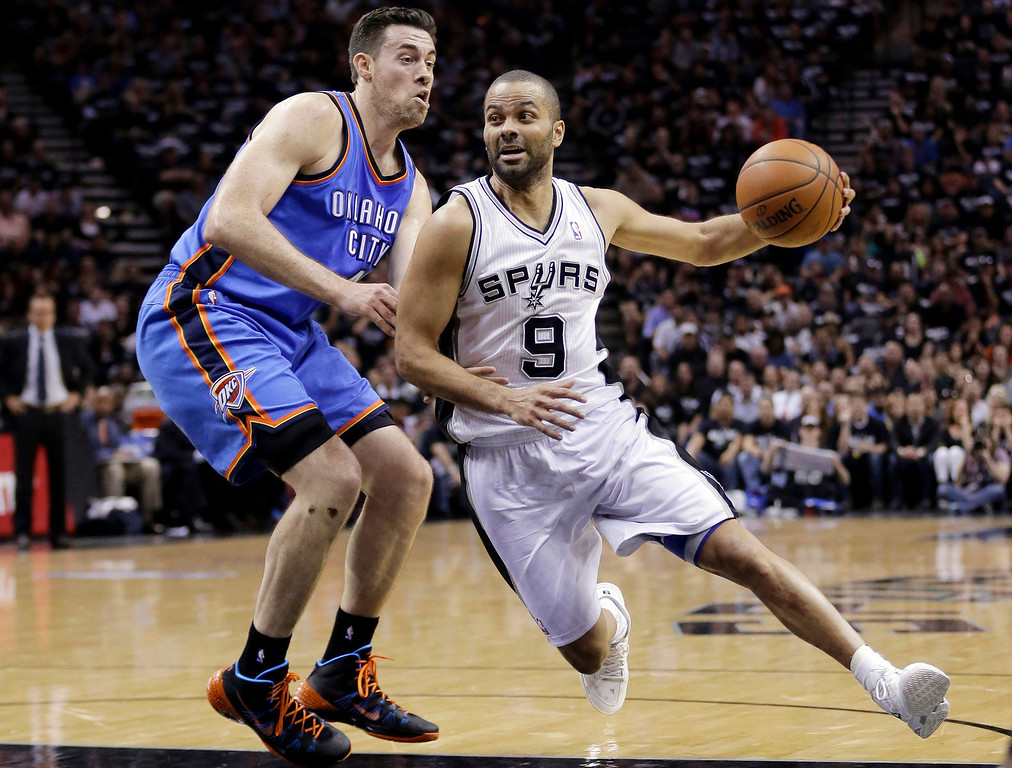 . San Antonio Spurs\' Tony Parker (9), of France, drives around Oklahoma City Thunder\'s Nick Collison during the first half of Game 1 of a Western Conference finals NBA basketball playoff series, Monday, May 19, 2014, in San Antonio. (AP Photo/Eric Gay)