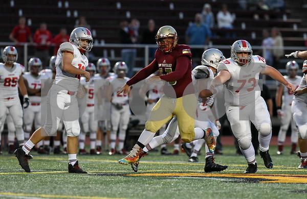 09/08/17 Wesley Bunnell   Staff New Britain High School football vs Conard at Veteran's Stadium on Friday evening. Outside linebacker Giovanii Cirrina (55)