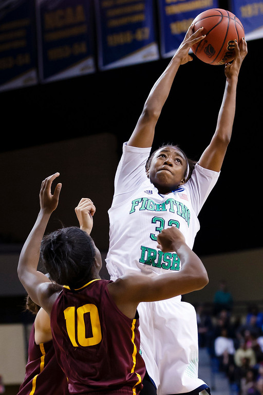 . Notre Dame guard Jewell Loyd (32) grabs the rebound over Arizona State guard Promise Amukamara (10) during the second half in a second-round game in the NCAA women\'s college basketball tournament in Toledo, Ohio, Monday, March 24, 2014. (AP Photo/Rick Osentoski)