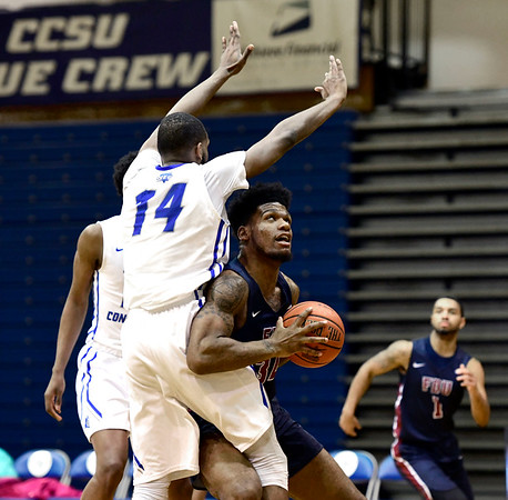 3/2/2019 Mike Orazzi | Staff CCSU's Deion Bute (14) and Fairleigh Dickinson's Mike Holloway Jr. (34) during Saturday's Mens basketball game in New Britain.