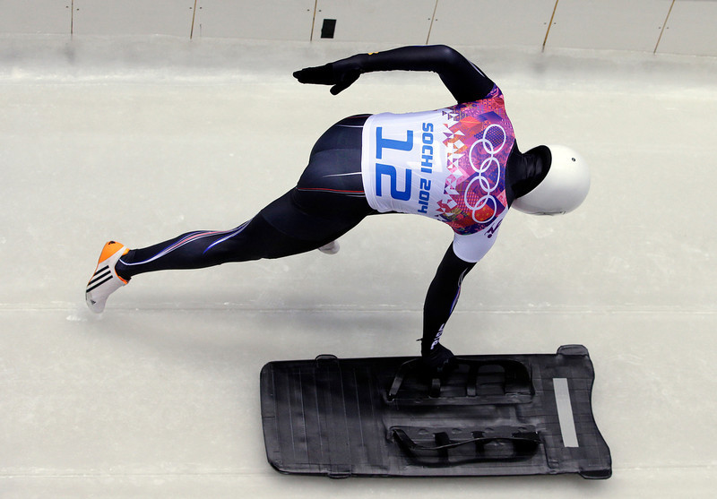. Kyle Tress of the United States starts his first run during the men\'s skeleton competition at the 2014 Winter Olympics, Friday, Feb. 14, 2014, in Krasnaya Polyana, Russia. (AP Photo/Michael Sohn)